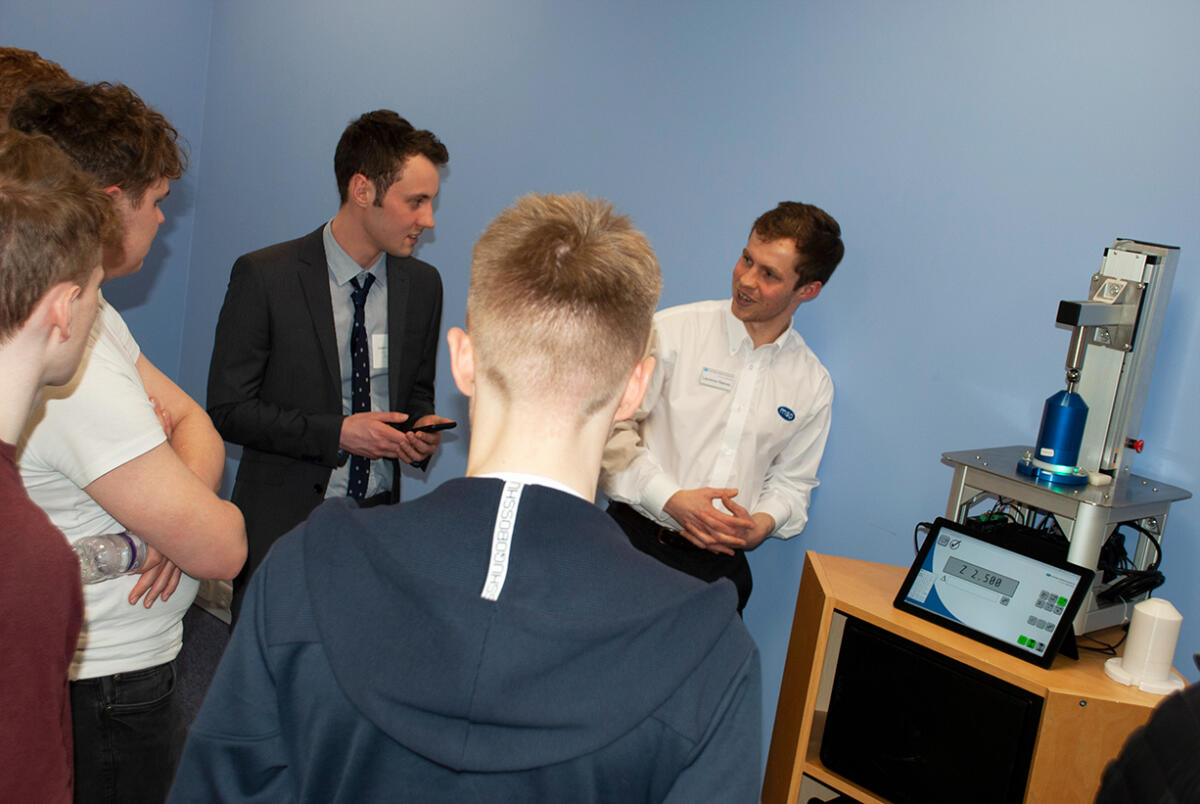 Laurence Reeves, Senior Engineer, (far right) demo's MSP's latest product AutoClock, to students.